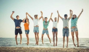multiethnic-group-of-people-jumping-at-beach-teenagers-young-476451219